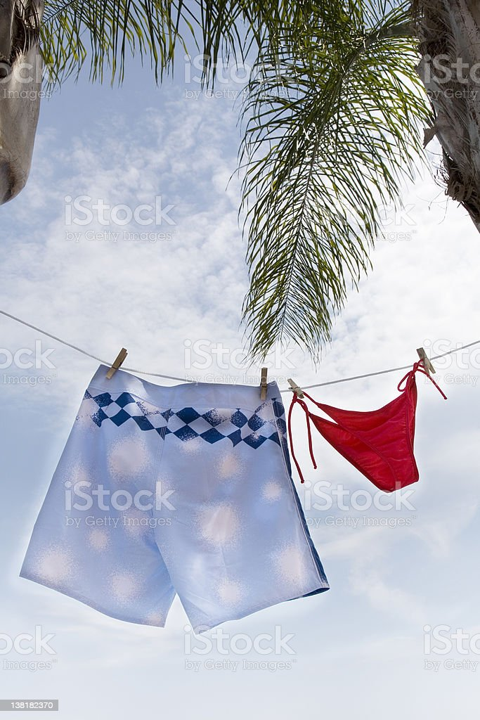 Man and woman swimming wear with palm tree royalty-free stock photo