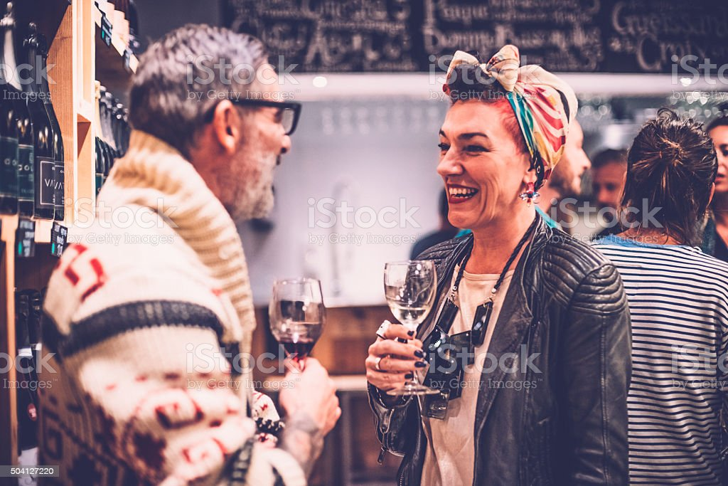 Man and Woman Talking in a Wine Bar stock photo