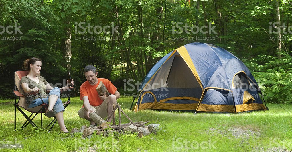 Man and Woman Tent Camping Making a Campfire stock photo