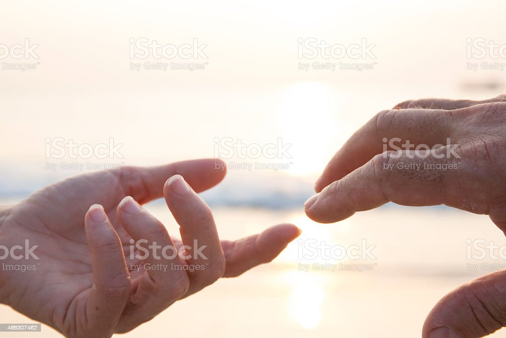 Man and woman touch fingers, close-up of hands stock photo