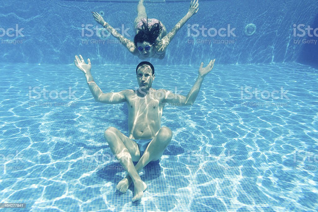 man and woman underwater royalty-free stock photo