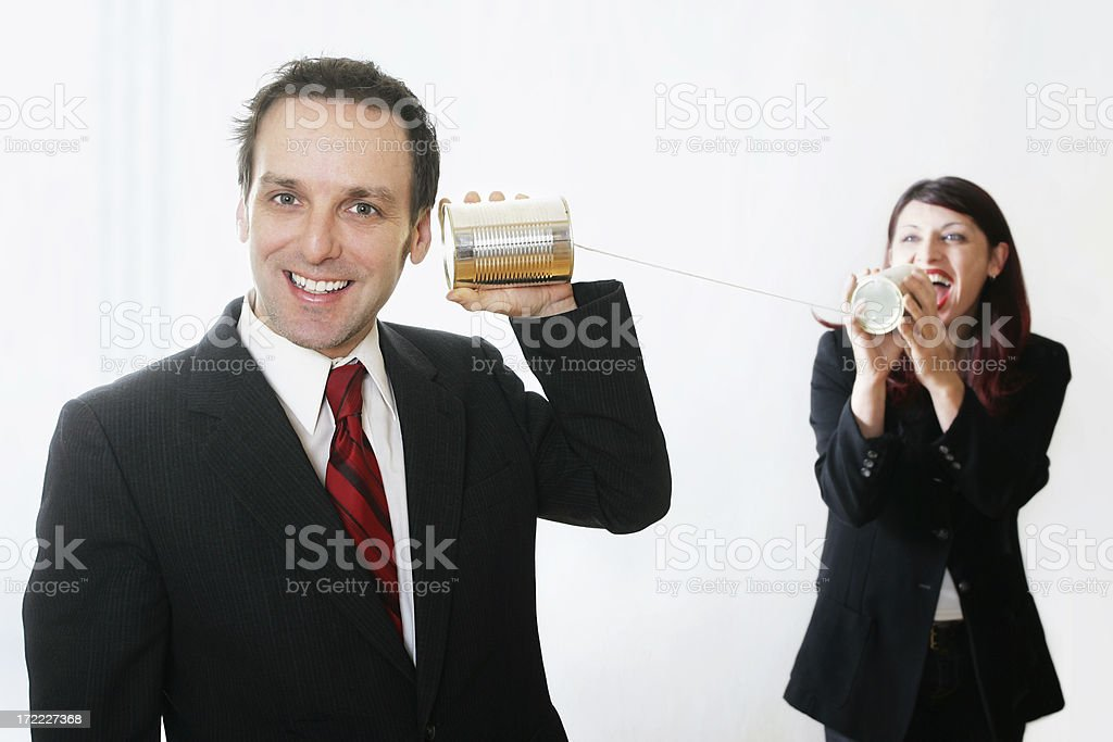 Man and woman using phone can royalty-free stock photo
