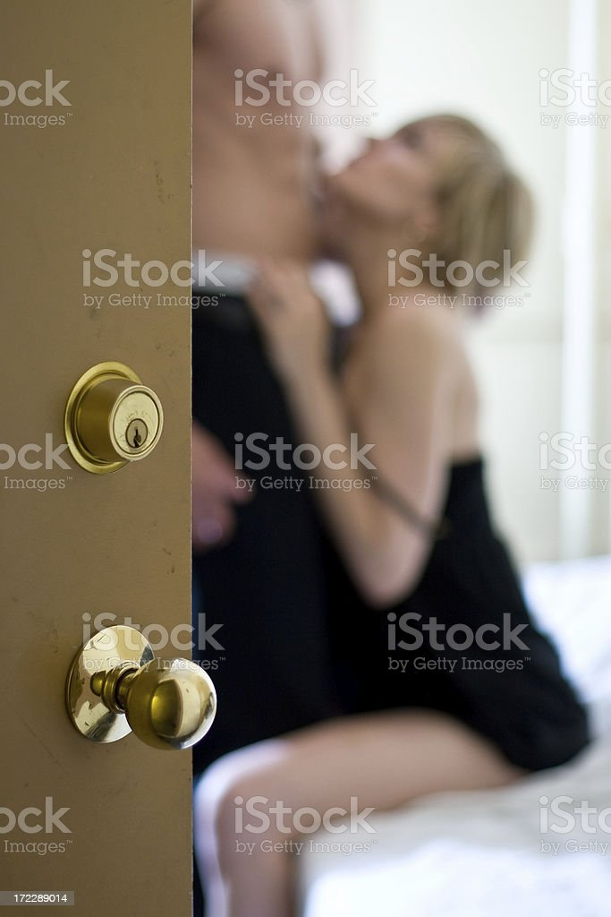 Man and woman viewed through a room door royalty-free stock photo