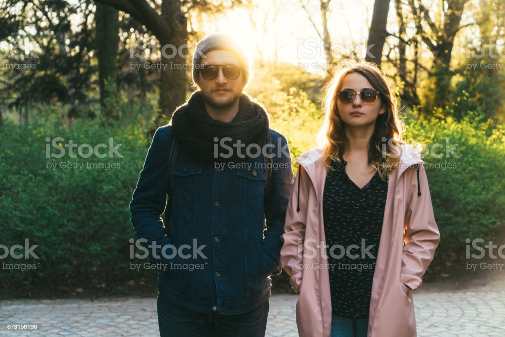 Man and woman walking in Łazienki Park in Warsaw  at sunset stock photo