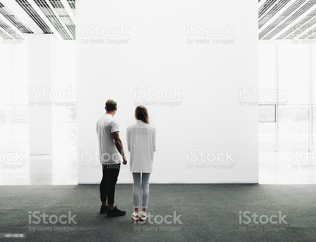 Man and woman walking through the gallery stock photo