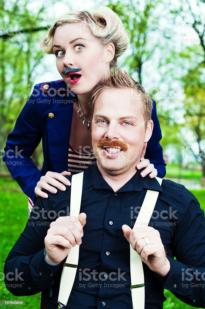 Man and woman wearing fake mustaches royalty-free stock photo