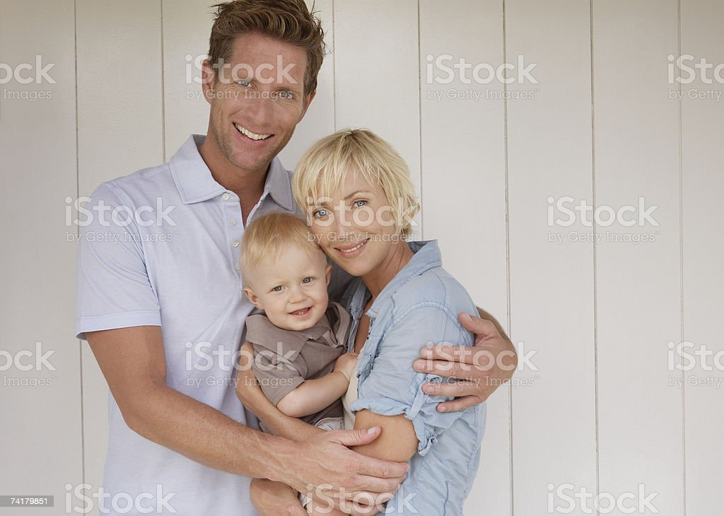 Man and woman with baby royalty-free stock photo