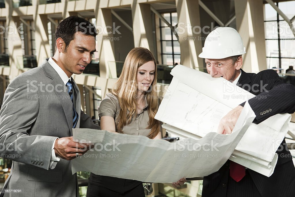 Man and Woman with Construction Worker stock photo