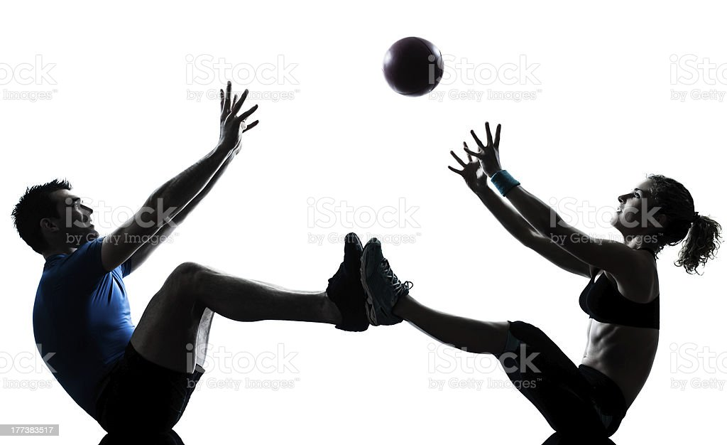 Man and woman with fitness ball royalty-free stock photo