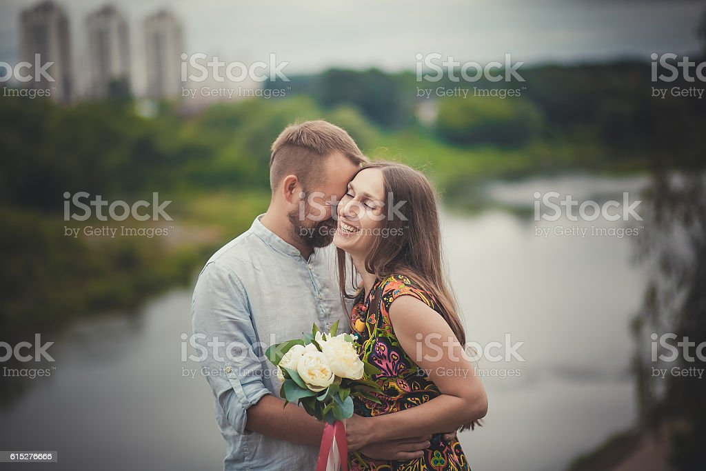 man and woman with flowers in nature royalty-free stock photo