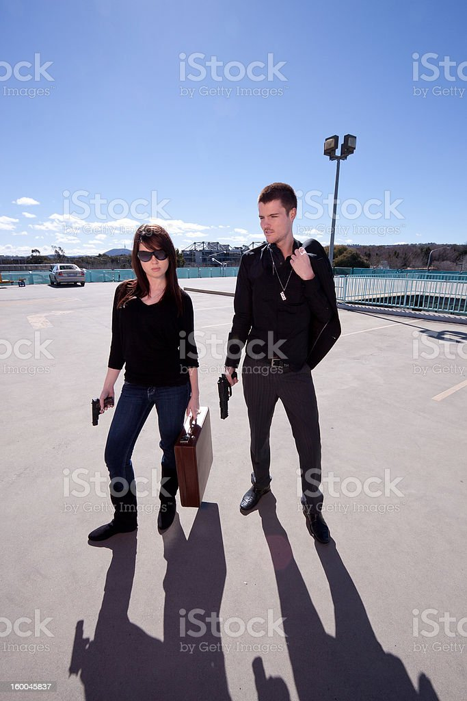 Man and woman with guns royalty-free stock photo