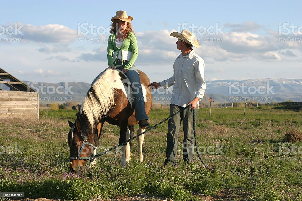 Man and Woman with Horse in Rural Country Setting royalty-free stock photo