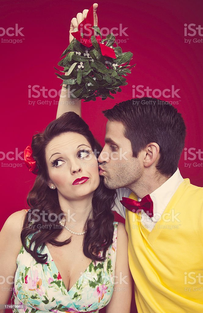 Man and Woman with Mistletoe stock photo