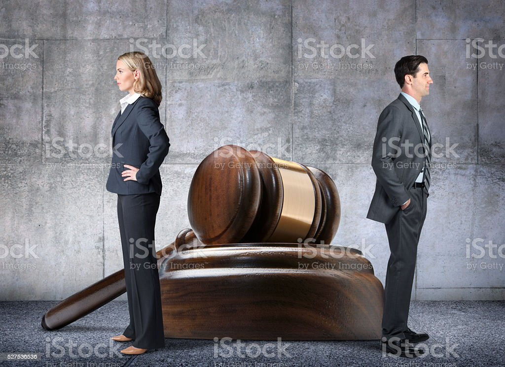 Man And Woman With Opposing Legal Points Of View stock photo