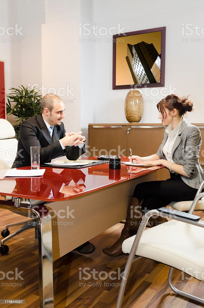 Man and woman working on a deal royalty-free stock photo