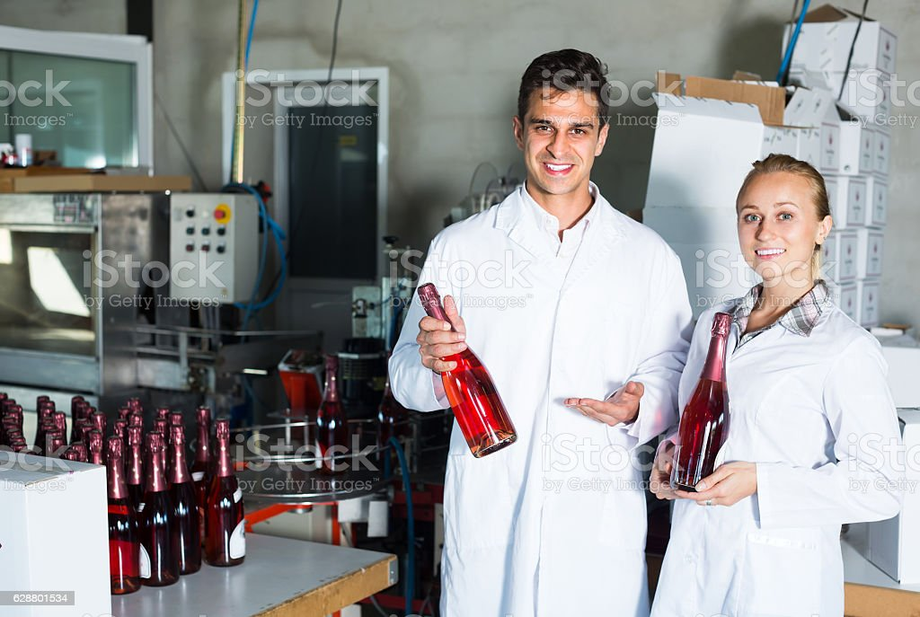 man and woman working on wine production stock photo