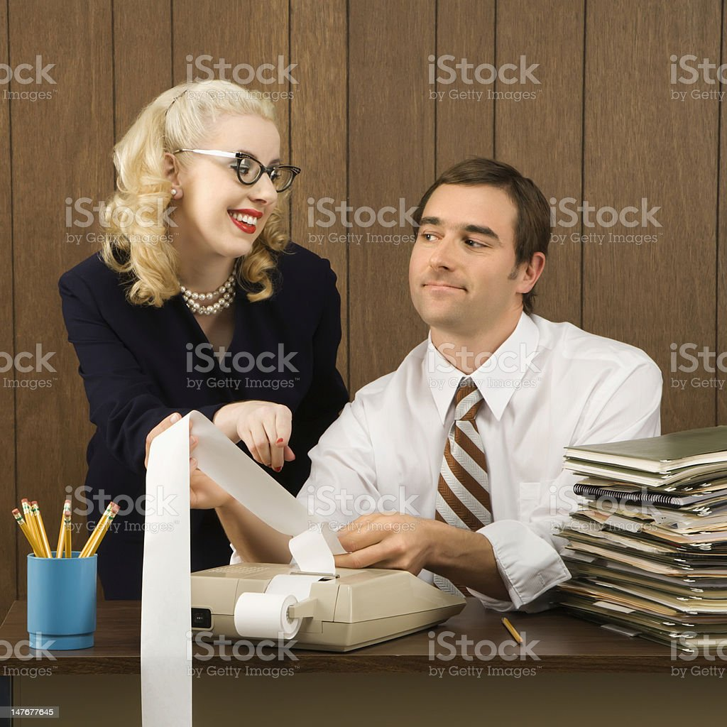 Man and woman working. stock photo
