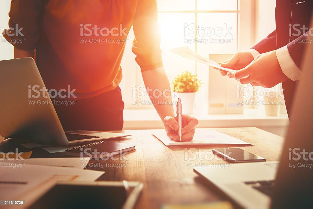 man and woman working stock photo