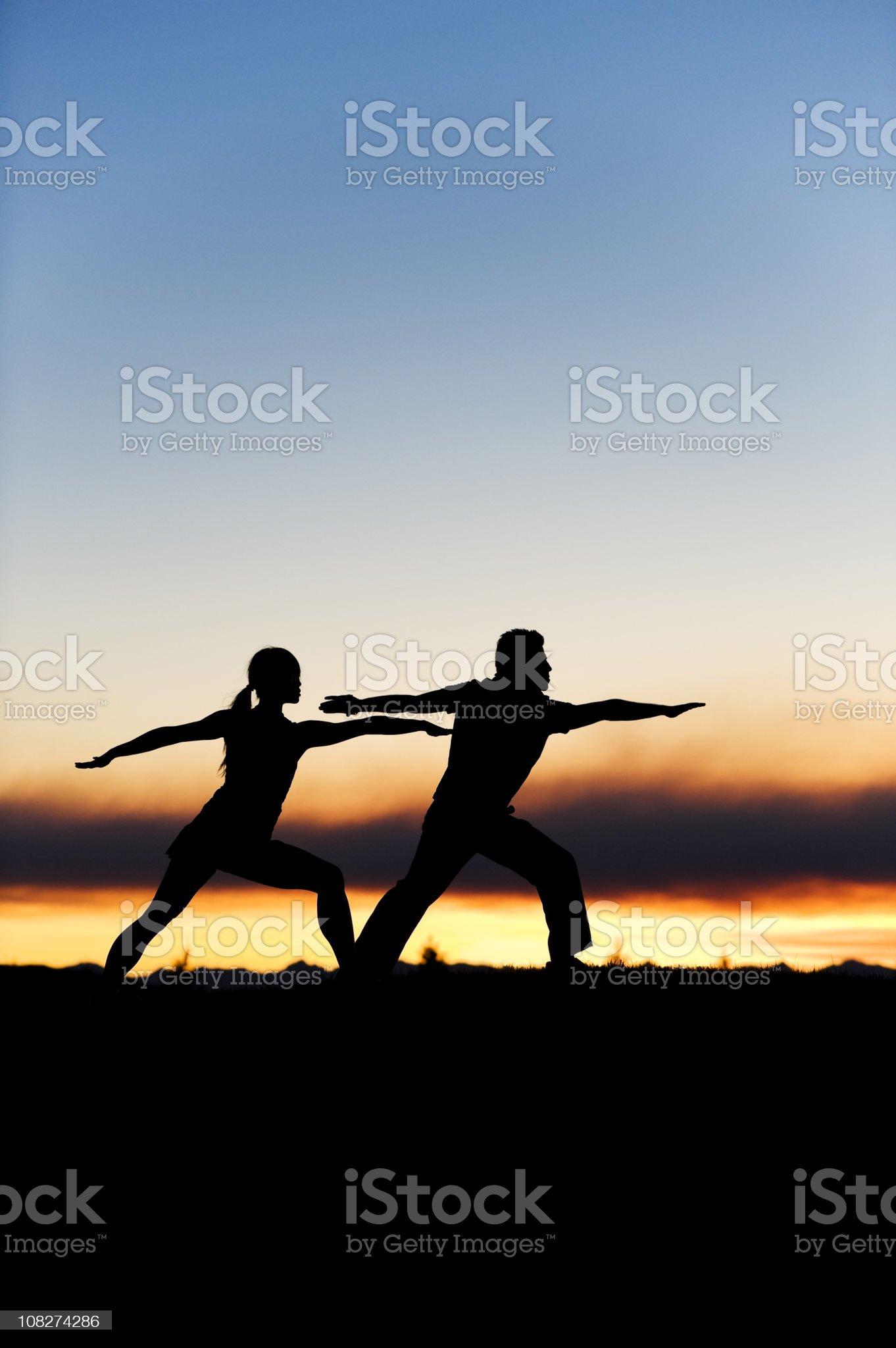 Man and Woman Yoga Pose royalty-free stock photo
