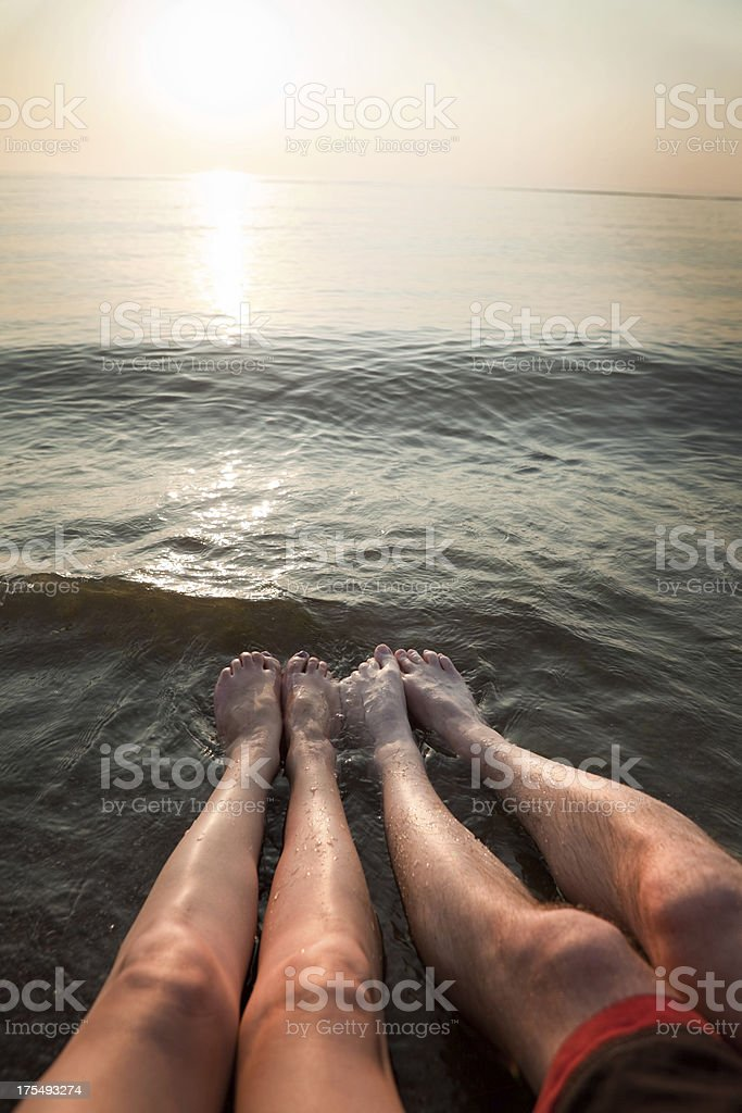 Man and Womans Legs in Beach royalty-free stock photo