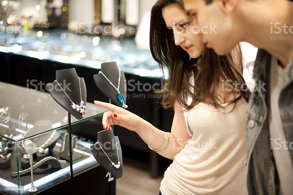 Man and women picking out jewelry stock photo