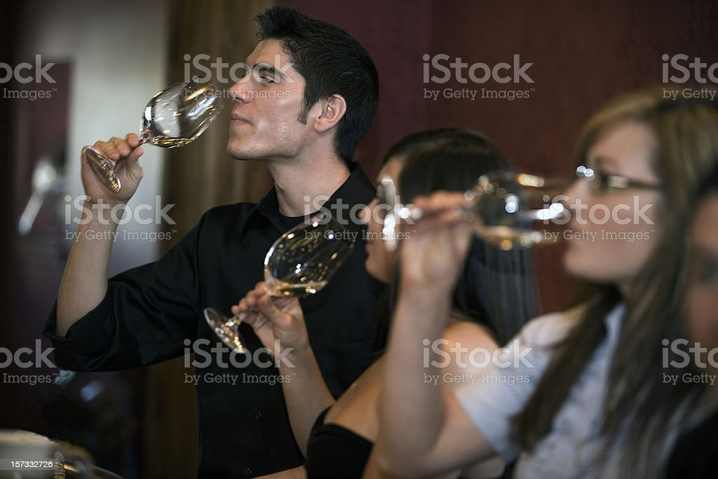 Man and women tasting different wines royalty-free stock photo