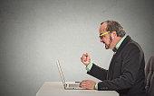man angry frustrated at computer