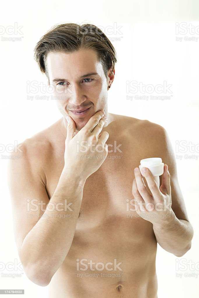 Man applying cream on face royalty-free stock photo