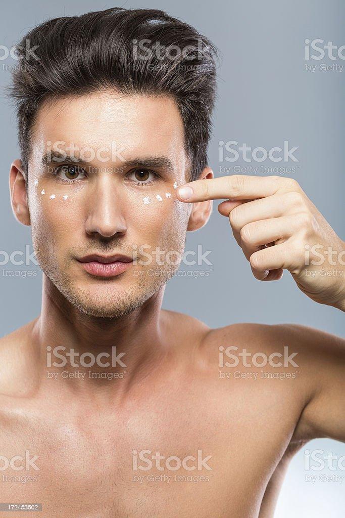 Man applying face cream royalty-free stock photo