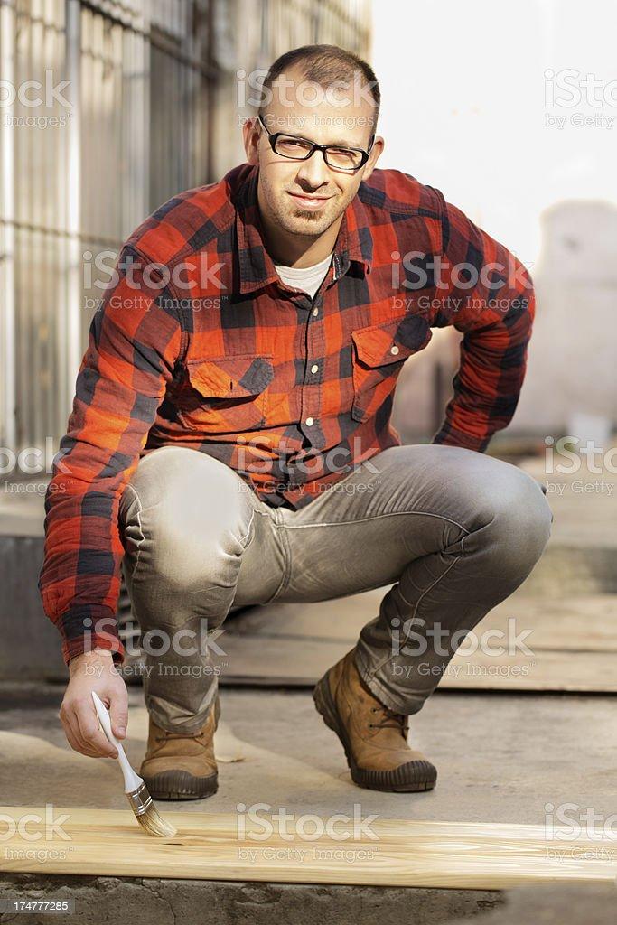 Man applying wood stain royalty-free stock photo