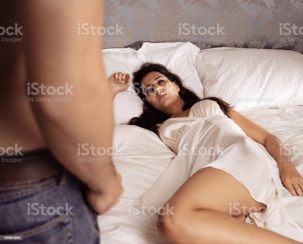 Man approaching woman in bed royalty-free stock photo