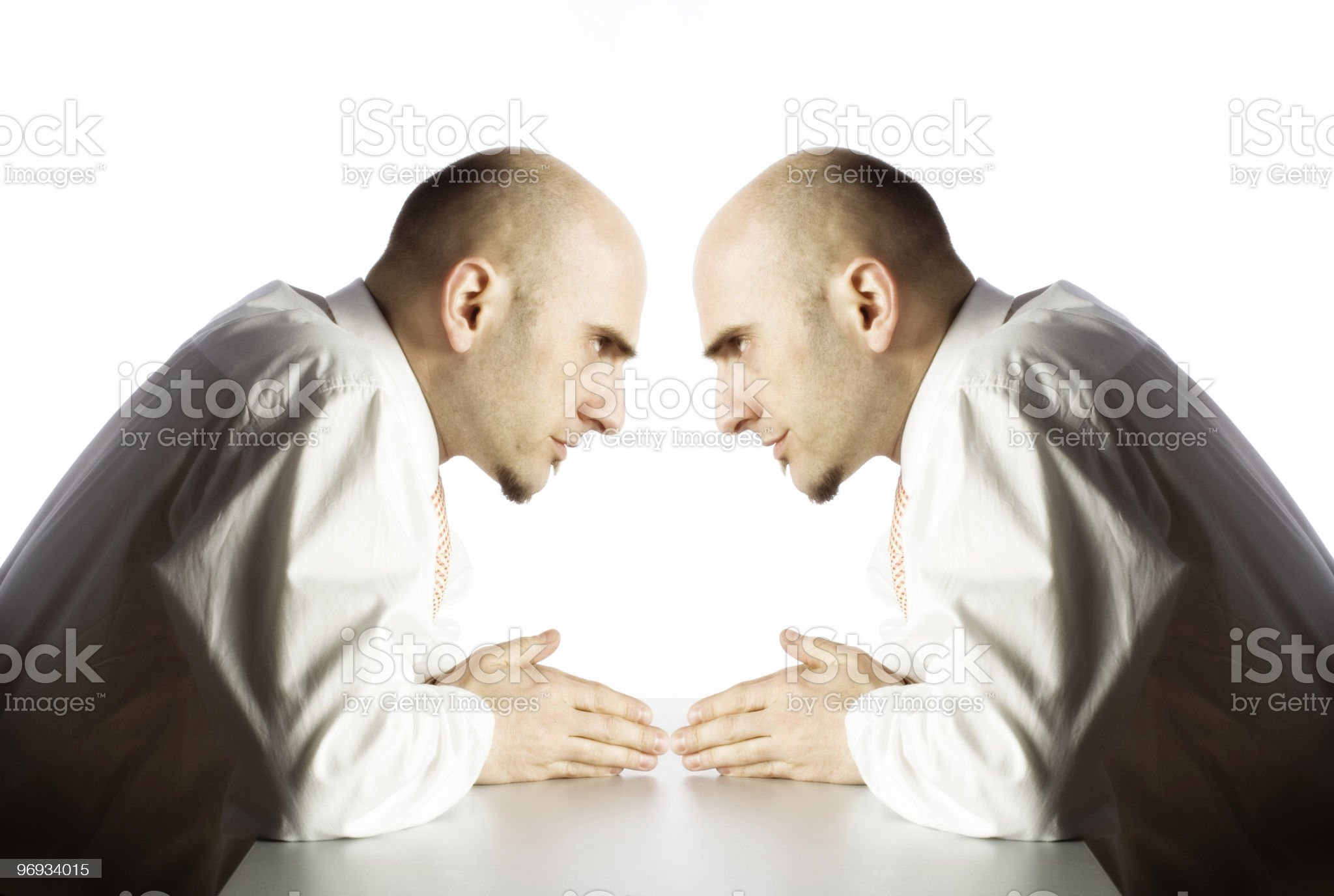 Man argues with himself royalty-free stock photo
