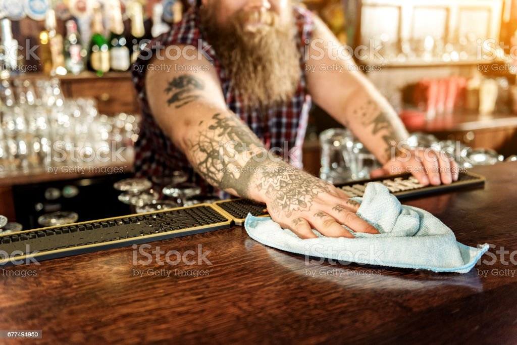 Man arm wiping counter in beerhouse stock photo