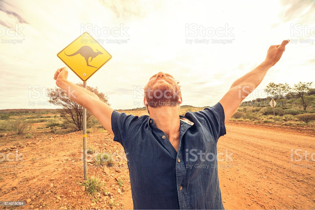 Man arms outstretched in Australia stock photo