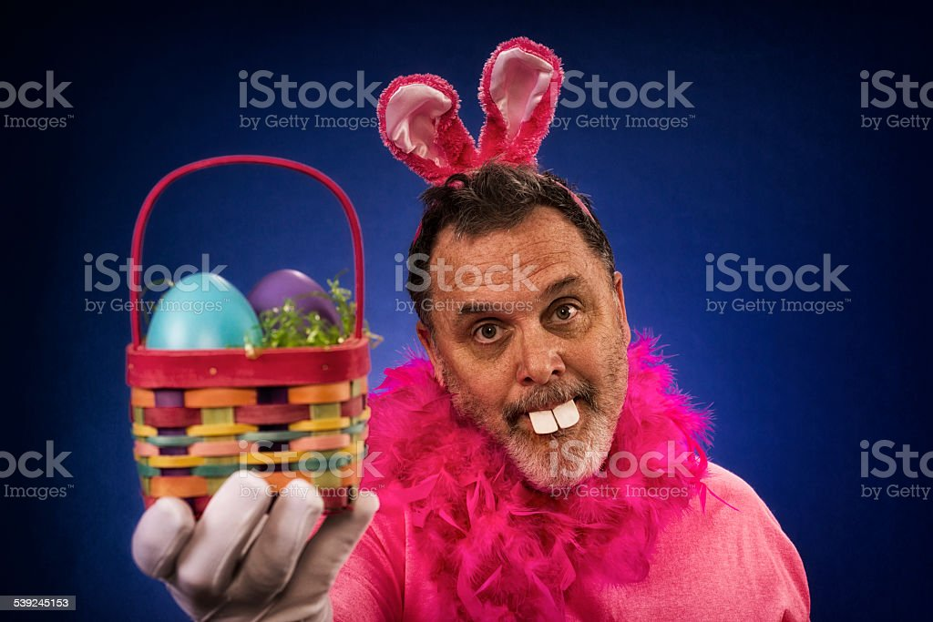 Man as Deranged Easter Bunny offering basket stock photo