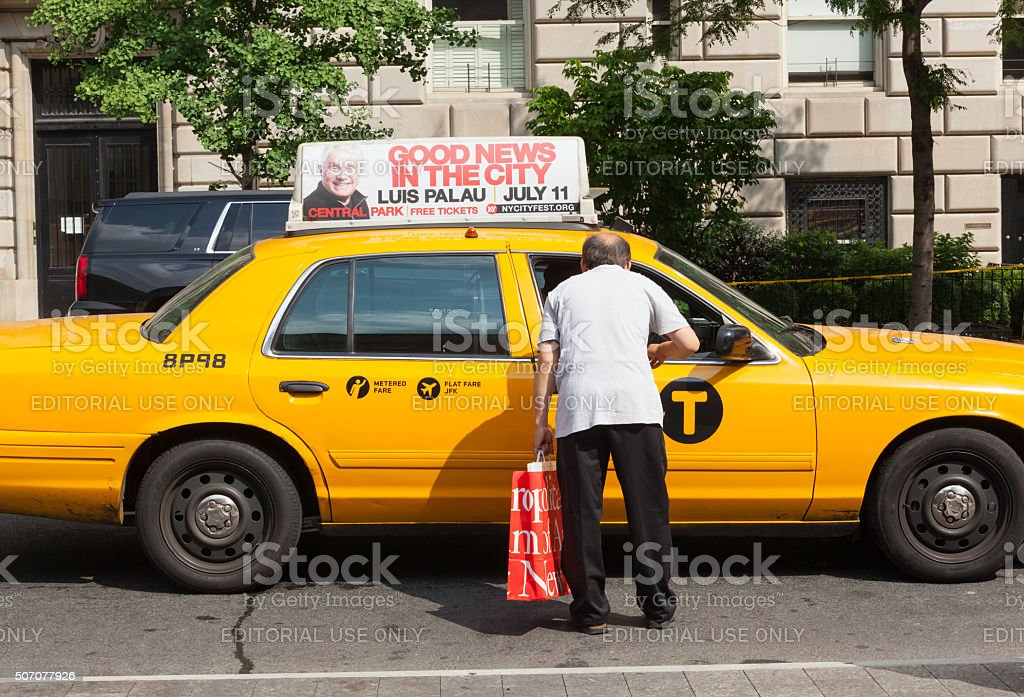 Man asks for information a taxi driver in Manhattan. stock photo