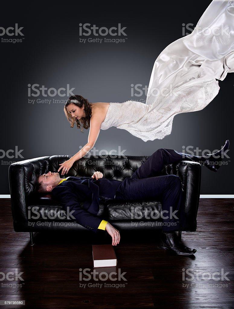 Man asleep fantasizing about his dream girl stock photo