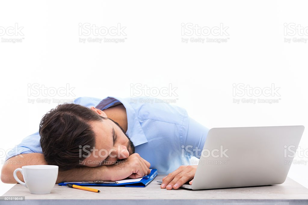 Man asleep in office stock photo