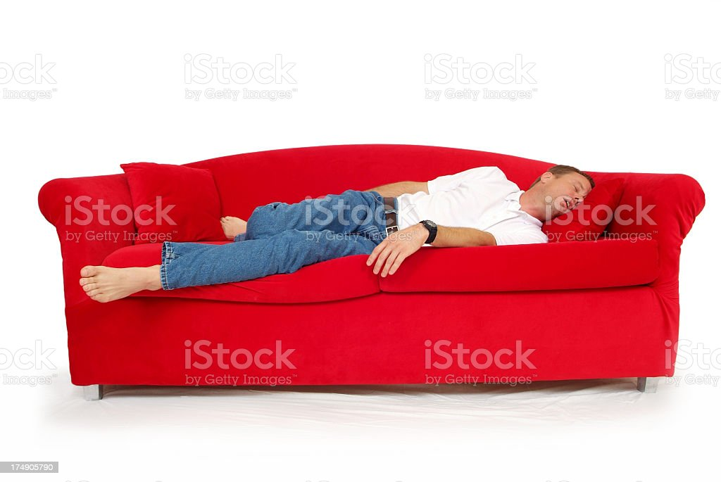 Man Asleep on a Red Couch with a White Background royalty-free stock photo