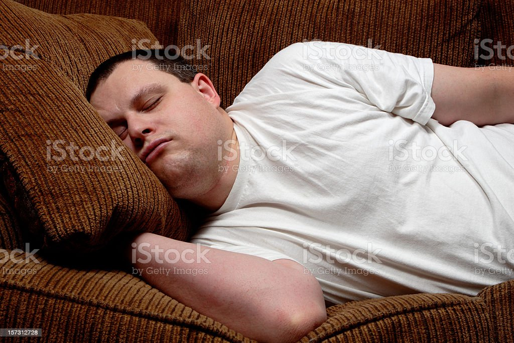 Man Asleep On Sofa stock photo