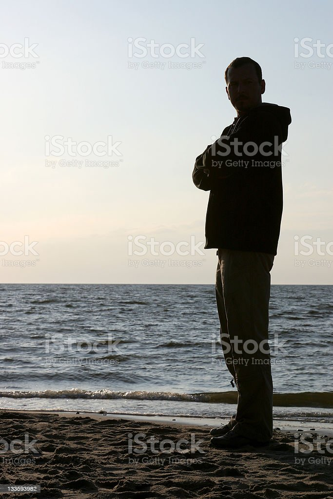 Man at beach silhouette stock photo