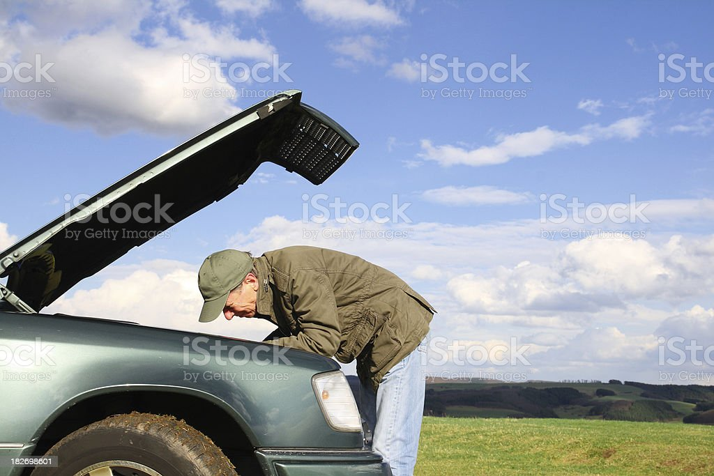 Man at Broken Car with open Hood royalty-free stock photo