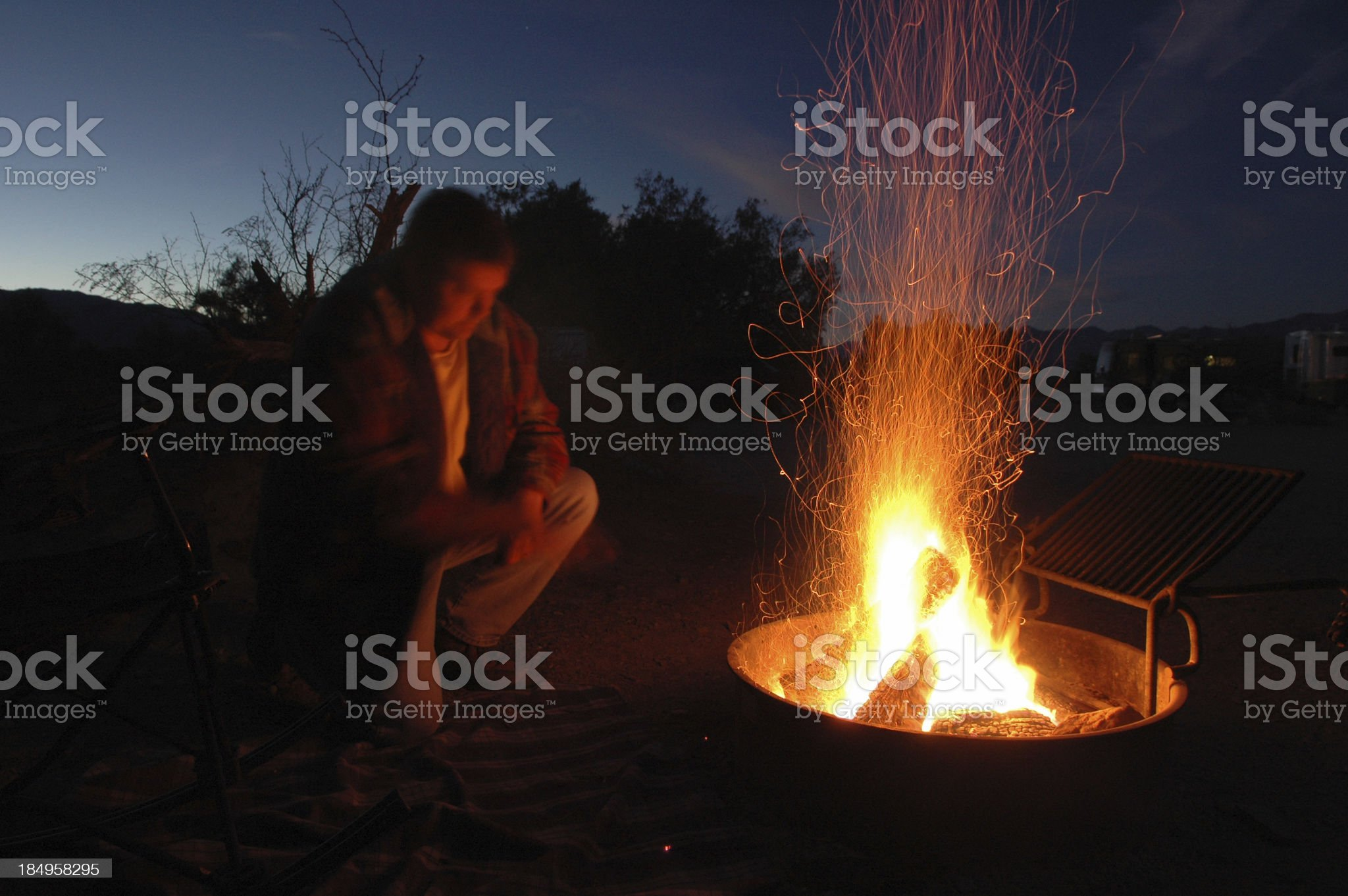 man at camp fire royalty-free stock photo