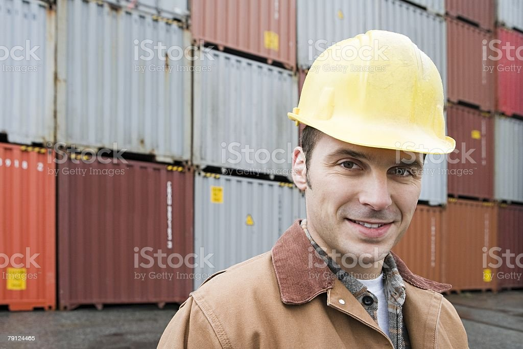 Man at container terminal stock photo