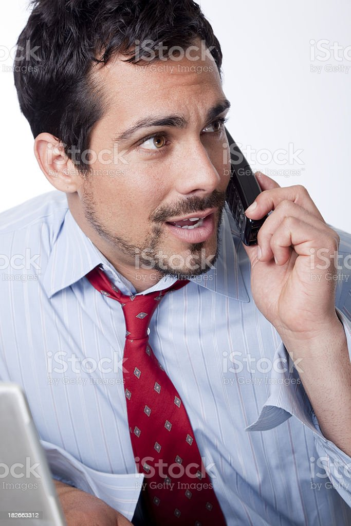 man at desk talking on the phone stock photo