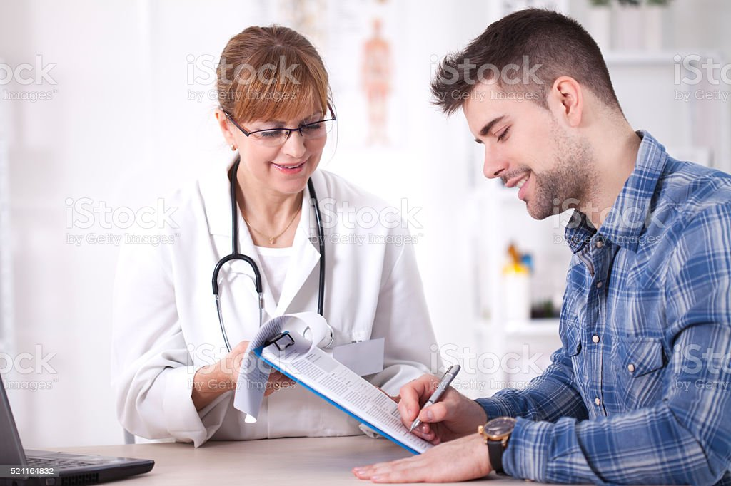 Man at doctor's office. stock photo