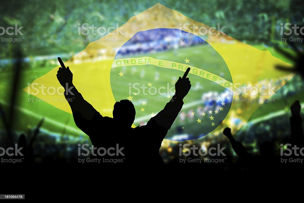 Man at footfall game and Brazilian flag background royalty-free stock photo