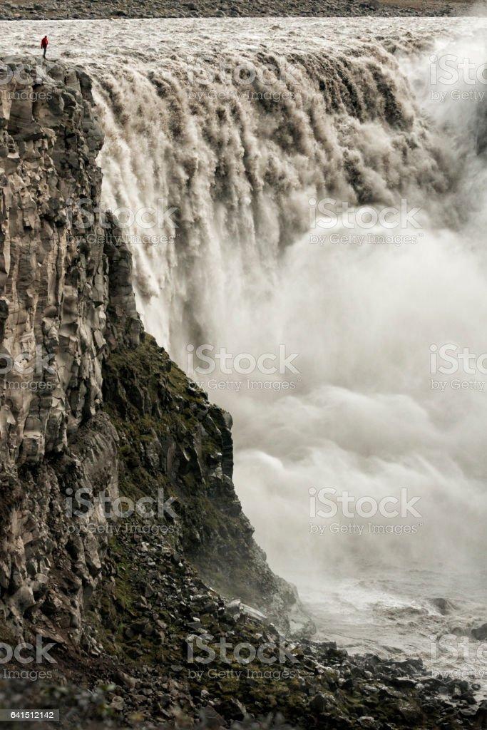 Man at gigantic Icelandic waterfall stock photo