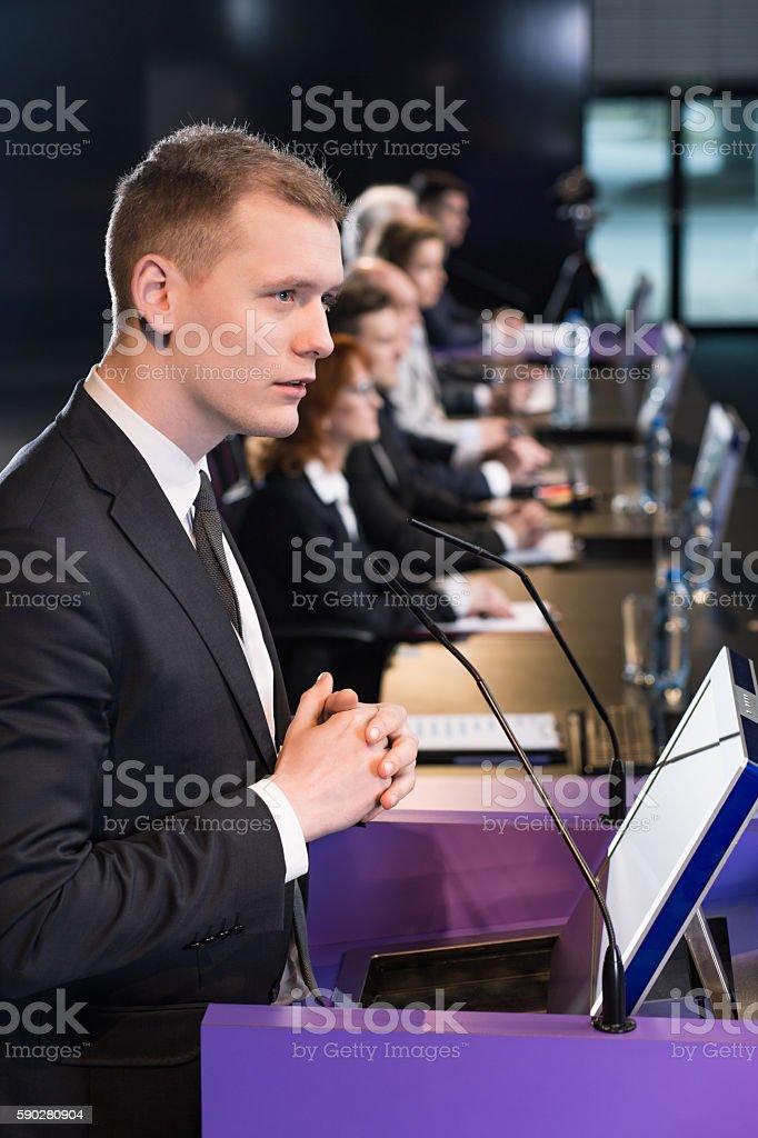 Man at lectern stock photo