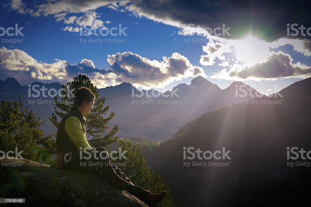 Man at mountain sunrise stock photo